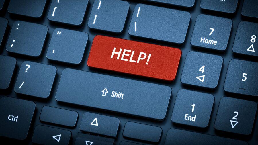 "Sort computertastatur med rød ""HELP""-knap."